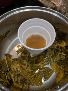 kratom tea in pot in cup